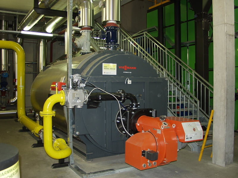 Grey commercial boiler with piping